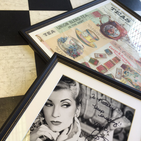 Fresh off the bench... Natalie's signed photograph and 'Tea' wrapping paper, preserved behind glass!