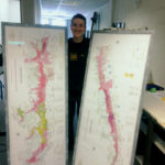 Nat posing with the large maps....